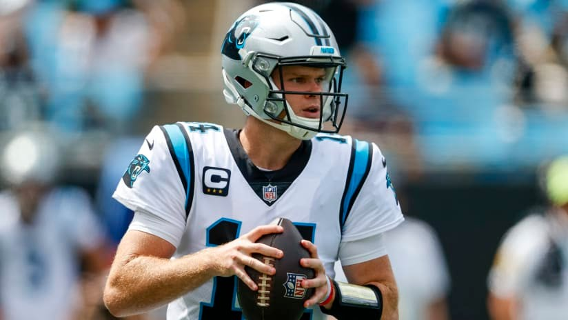 Carolina Panthers quarterback Sam Darnold looks to pass against the New Orleans Saints during the first half of an NFL football game Sunday, Sept. 19, 2021, in Charlotte, N.C. (AP Photo/Nell Redmond)